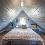 Beach Style Attic Bedroom Whitewashed Ceiling And Wall Small Center Window Wood Plank Floors
