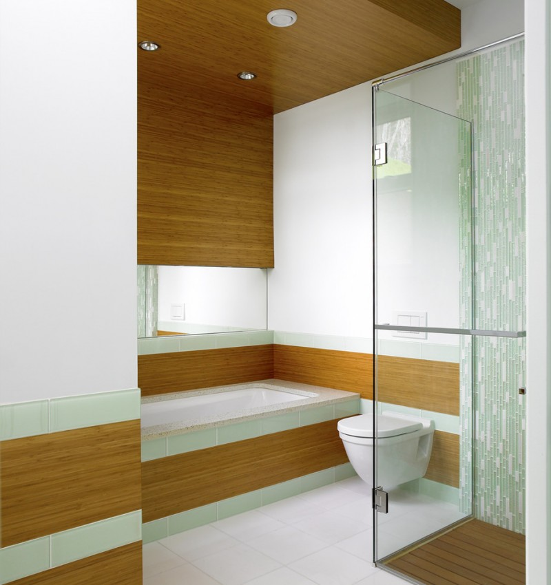 contemporary bathroom design bamboo walls and ceilings wall mounted toilet in white walk in shower with bamboo floors and clear glass door panel white bathtub with bamboo accent wall