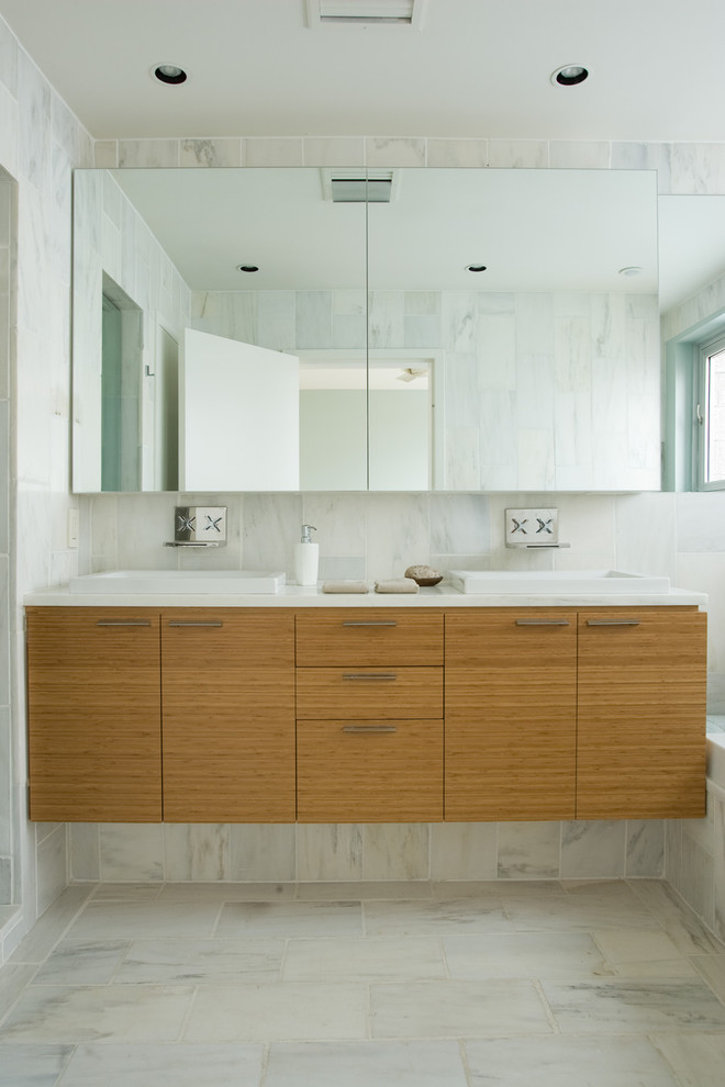 contemporary bathroom floating bamboo flat paneled cabinets with white countertop white and undermount sink frameless mirror white marble walls white marble floors