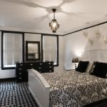 Contemporary Bedroom Design White Bed Frame With Headboard Black White Bedding With Traditional Patterns Black Dresser Monochromatic Area Rug