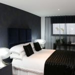 Contemporary Bedroom Idea White Bed Linen Black Pillowcases White Pillowcases Bed Frame With Higher Velvet Headboard In Dark Blue Dark Wallpaper In Blue Transparent Black Lace Window Curtain