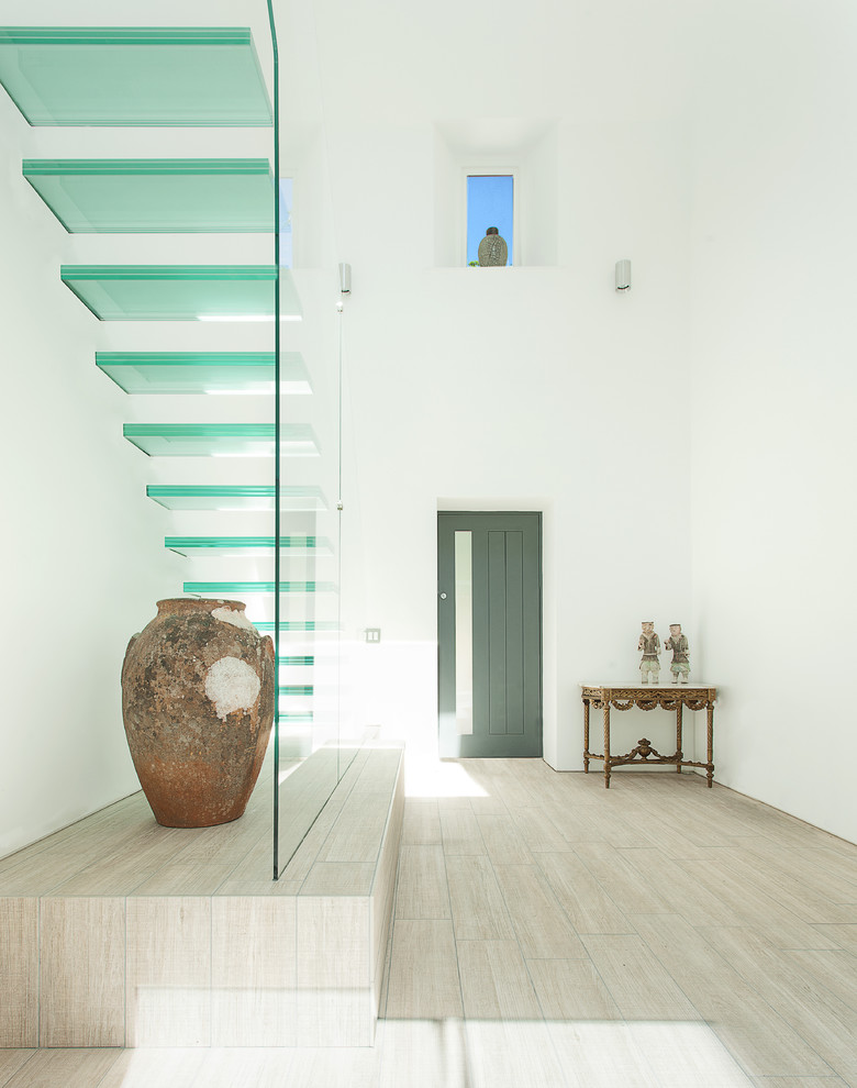 contemporary floating glass staircase with glass steps and glass railings