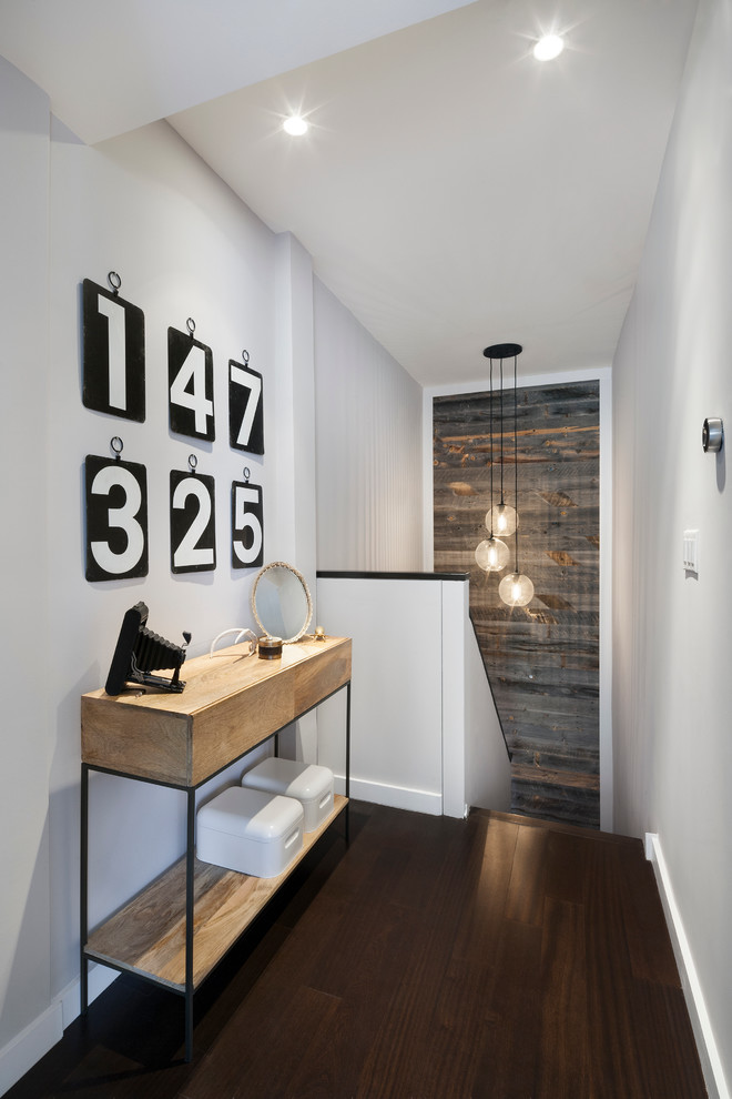 contemporary hallway idea dark wood floors industrial hall console table clean look wall in white clear glass pendants wood reclaimed wall nearest the stairs