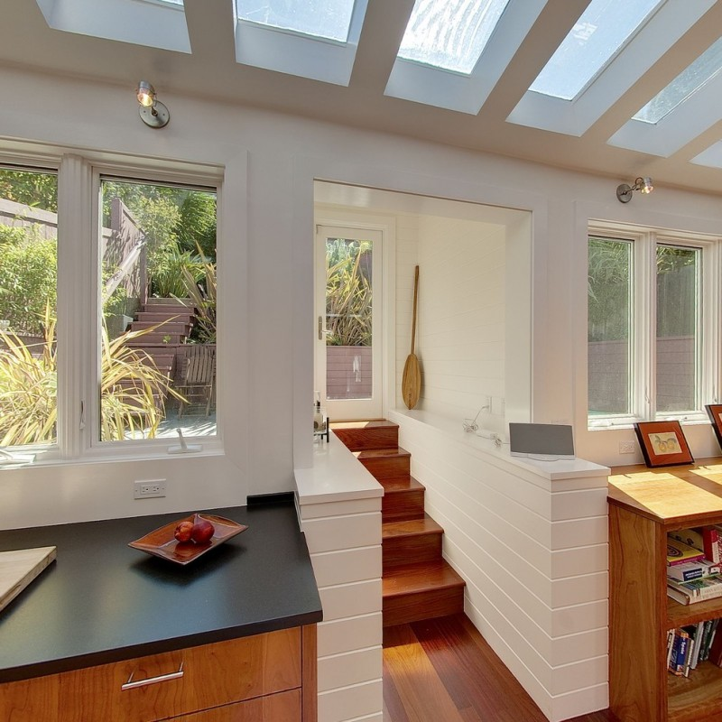 contemporary interior frosted glass roofs framed with concrete beams glass windows solid cherry entrance stairs white subway tiles solid cherry floors solid cherry cabinets