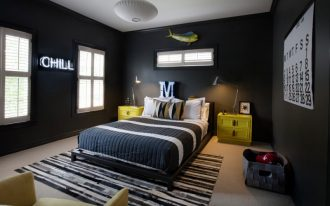 contemporary kids bedroom design black wall color with custom letter neons striped black white bedding striped black white area rug yellow finish bedside tables