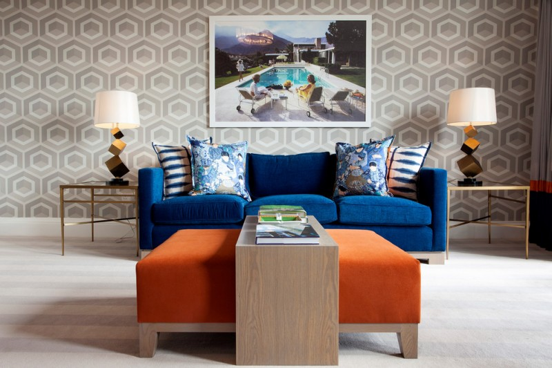 contemporary living room contemporary wallpaper in gray blue velvet sofa blue accent pillows orange coffee table with solid wood additional table light wood floors