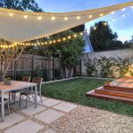 Contemporary Patio Idea Square Shaped Concrete Pavers With Additional Stones Base A Set Of Outdoor Furniture Thin White Shade With Strings Of Bulbs