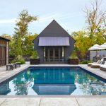 Contemporary Poolside Idea With Concrete Hardscape