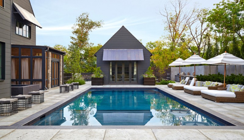 contemporary poolside idea with concrete hardscape