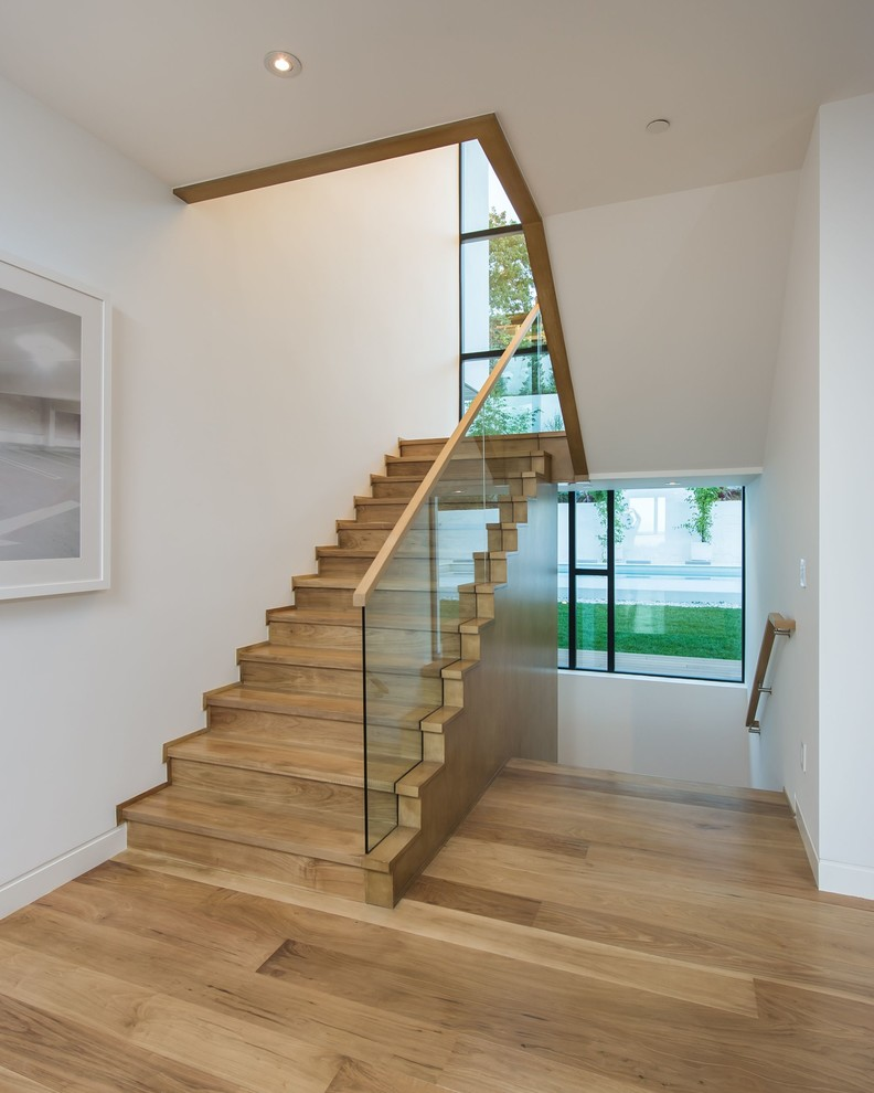contemporary staircase wooden steps clear glass staircase railings with wood banisters