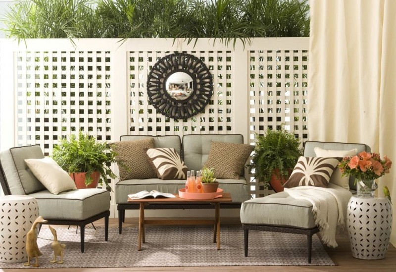 eclectic patio modern black wrought iron chairs wooden center table white thick square lattice panel decorative wall mirror in round shape decorative corner vase