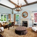 high ceiling living room simple white ceilings with exposed wood beams ottoman tufted table with slipcover brown velvet sofa black wrought iron coffee table white armchair with wood construction