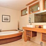 master bathroom in Asian style bamboo finishing cabinets hardwood bathroom vanity oval bathtub with bamboo accent