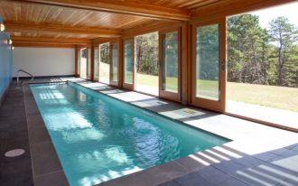 mid century modern indoor pool lower oak enclosure and glass windows