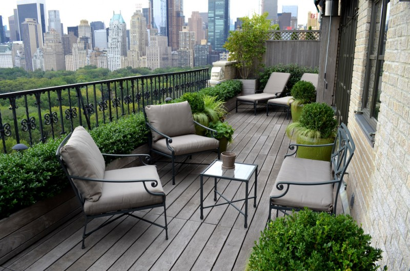 modern balcony idea black wrought iron railings black wrought iron outdoor furniture gray wood decking floors