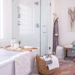 Modern Bathroom With Bohemian Touch Walk In Shower With Clear Glass Paneling White Tub Marble Floors Subway Tiled Walls In White Ethnic Rug