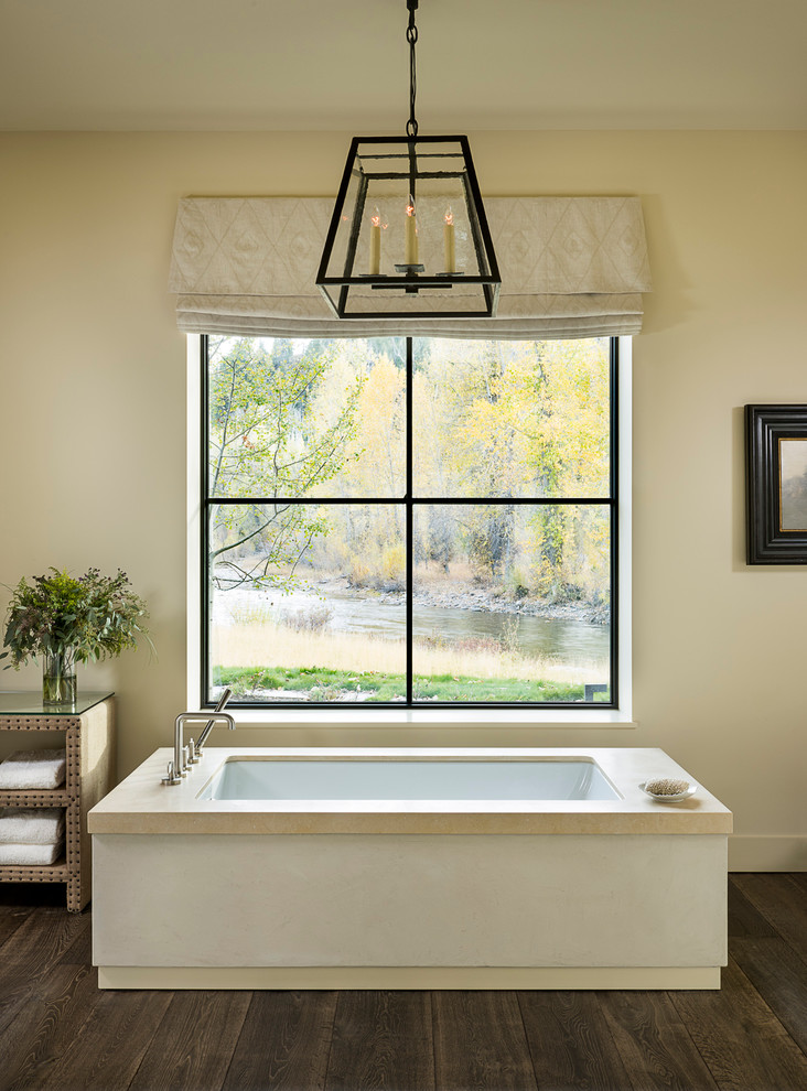 modern farmhouse bathroom custom modern bathtub in square shape large glass window with black metal trims industrial pendant white window skirt dark wood floors