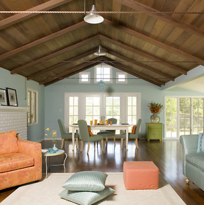 modern farmhouse idea egg blue wall color windows with white trims redwood ceilings and beams oak stained floors green dining chairs white dining table white area rug orange chair and ottoman