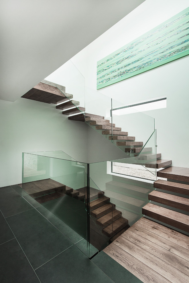 modern floating staircase with clear glass railings