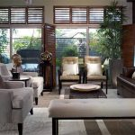 Modern Living Room With Asian Appeal Grey Sofas Interior Greens Dark Wood Floors Wood Trimmed Windows And Door With Shutters