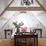 Modern Rustic Attic Bedroom Design Farmhouse Style Bed Frame With Canopy Farmhouse Style Chandelier Dark Wood Berside Tables Exposed Wood Ceiling Beams