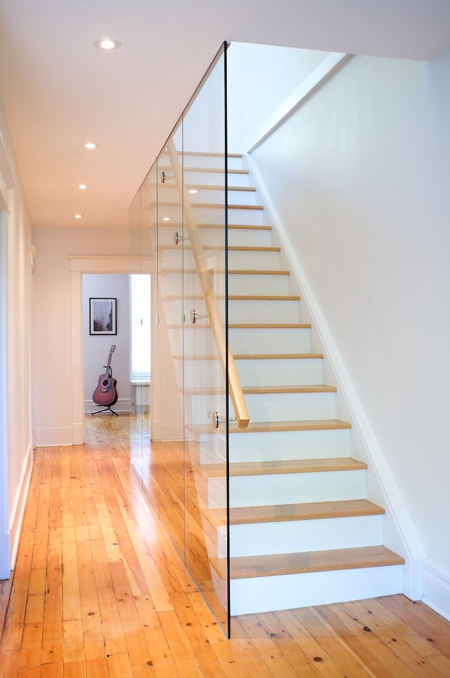 modern staircase with glass railings installed from floor to top