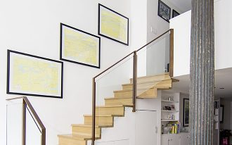 modern staircase with oak steps glass panels with black steel banisters