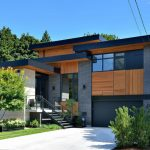 Multi Level Roof Contemporary Home Exterior In Wood Color And Darker Shades