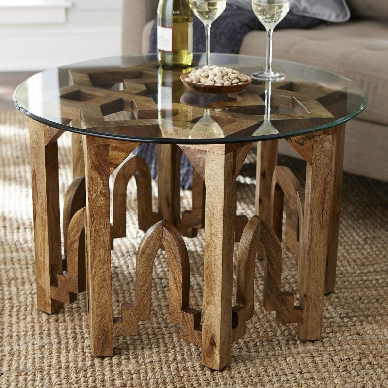 round glass top Moroccan coffee table with carved natural wood legs
