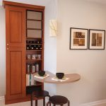 semi round floating table with two bar stools