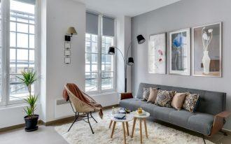 simple modern living room in grey grey mid century modern sofa modern floor lamps with black lampshades mid century modern chair and tables white shag rug
