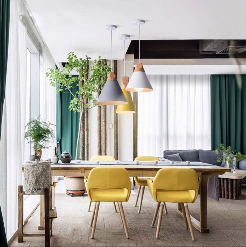 slope pendants in minimalist style pop of yellow chairs with angled wood legs wood table interior plant