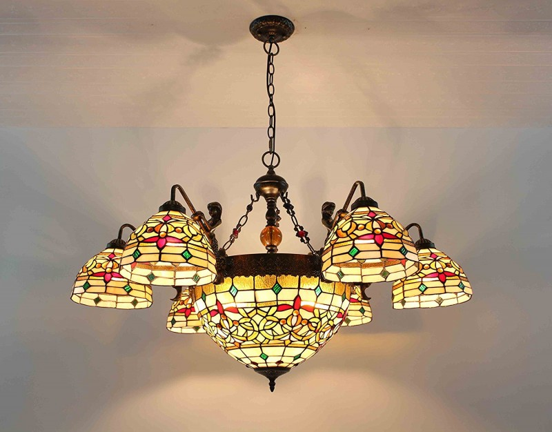 stained glass chandelier with turning bowls like lampshades and dark finish metal support & chain
