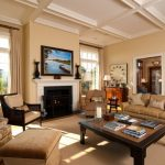 Tan Living Room Idea Caramel Toned Walls White Painted Ceilings Caramel Toned Area Rug Couches With Fabrics Dark Wood Furniture Set