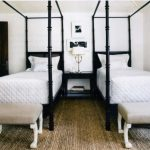 Traditional Bedroom Design Black Finish Twin Beds With Canopy White Bedding And Pillows Woven Rug Two Bed Bench