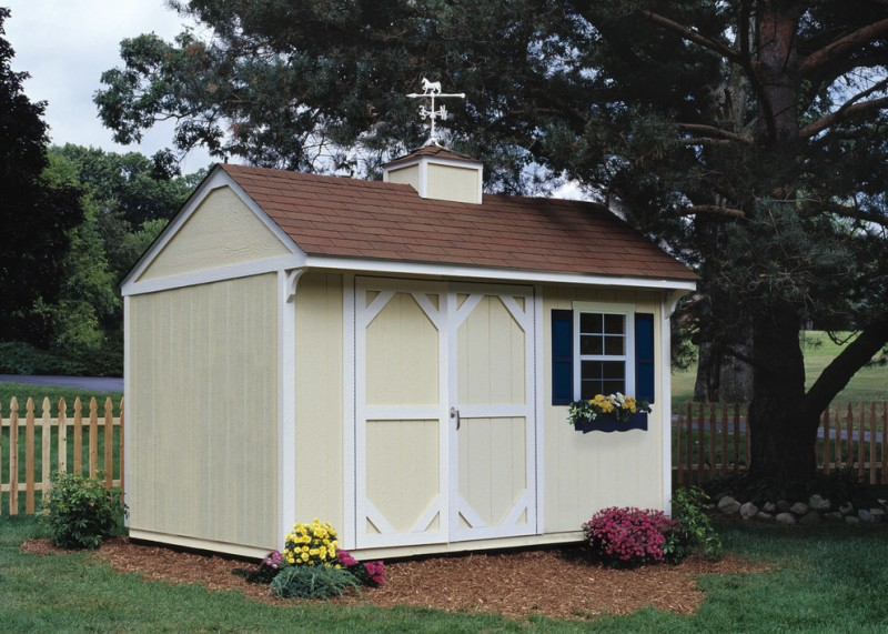 traditional garden shed design in light tone and window shutters