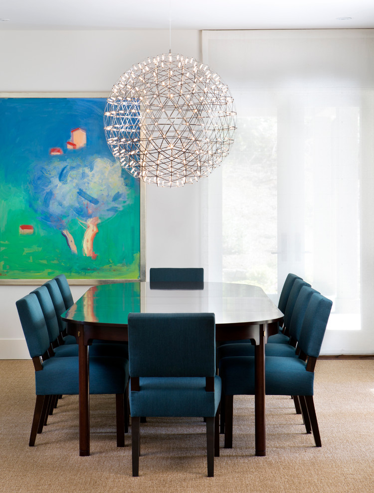 transitional dining room giant orb chandelier blue dining chairs dark wood dining table artistic abstract painting