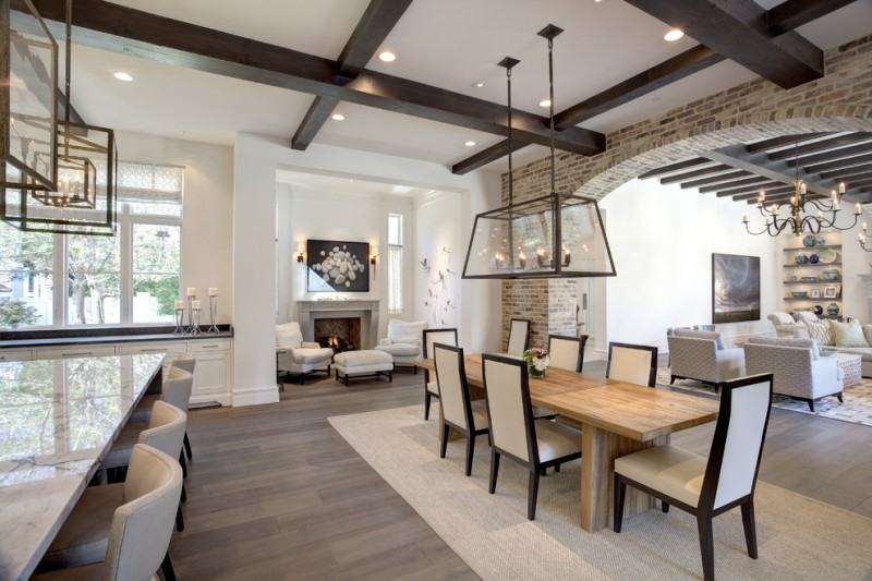 transitional dining room in modern rustic style industrial light fixture wood dining table modern dining chairs white oak floors white area rug