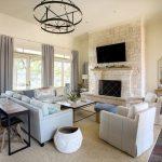 Transitional Living Room Light Cream Wall Color Light Cream Bricks For Fireplace's Surrounding Light Blue Sofa White Slipcover Chair Woven Area Rug Slate Floors