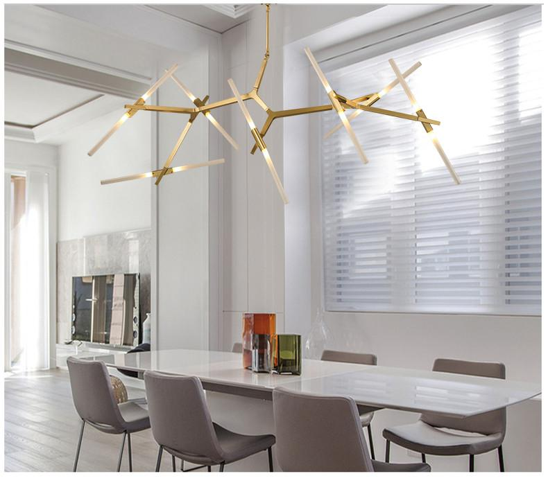 tree shape pendant in gold shade modern white dining table light gray dining chairs