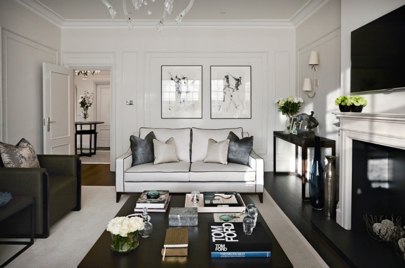 trendy living room idea white sofa with black accent lines black and white throw pillows black finish coffee tea table white area rug