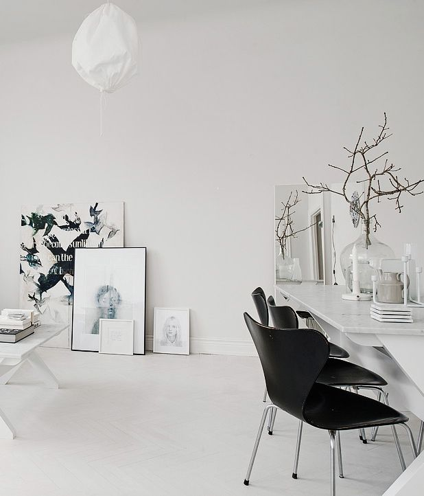 white interior Scandinavian idea monochromatic artworks black scandinavian chairs longer white table frameless mirror