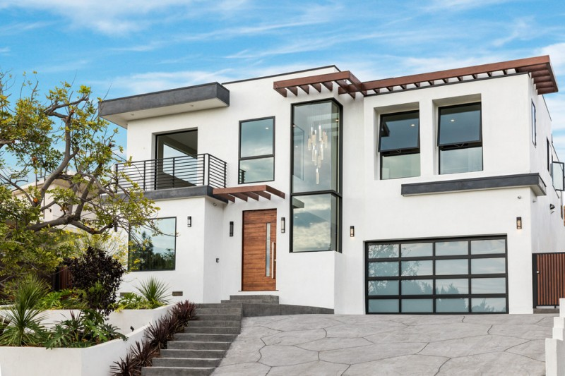 white two story home exterior in white and accented by black and brown shades