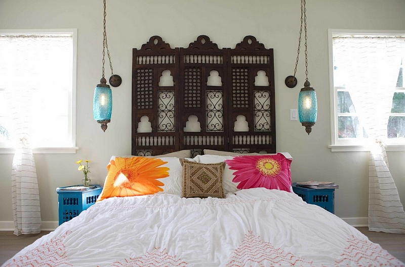 Mediterranean Moroccan bedroom idea dark finished Mashrabiya wood panel lantern shaped pendants in blue white bedding treatment flower pillowcased pillows dark neutral Moroccan pillow