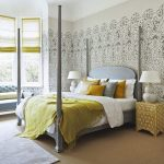 Middle East Inspired Wallpaper In Neutral Color Traditional Gray Bed Frame With Headboard And Canopy Yellow Bedside Tables Yellow Blanket