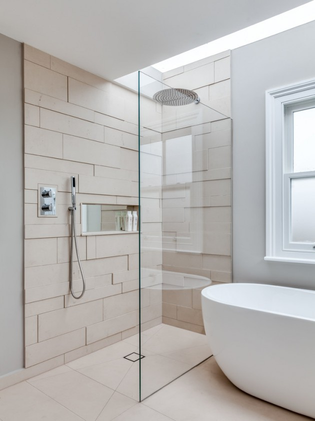 Scandinavian bathroom textured soft neutral walls clear glass shower panel white bathtub soft neutral floors