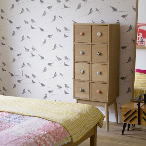 birds print bedroom wallpaper wood drawer system wood bed frame light wood floors
