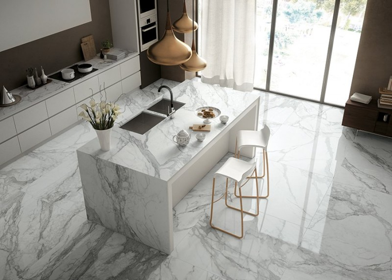 clean look and modern kitchen in white whita Italian marble floors white Italian kitchen Island kitchen counter with white marble top modern bar stools with gold toned legs pendants with brass la
