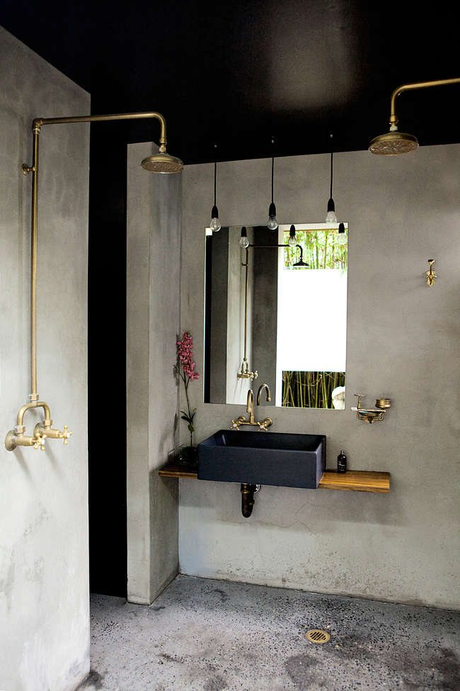 concrete finishing bathroom clean line bathroom vanity frameless mirror industrial pendants gold toned shower appliances concrete walls and floors