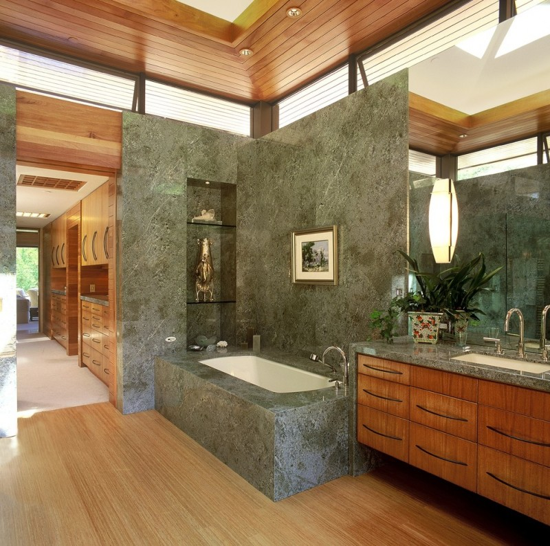 contemporary bathroom green marble walls green marble built in tub green marble counter floating wood vanity cabinets light wood floors